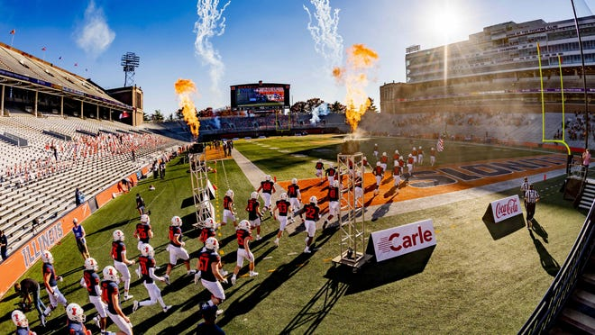 The Illinois football team runs onto the field during introductions prior to a game last week against Minnesota at Memorial Stadium in Champaign.