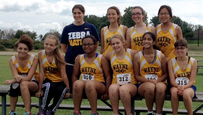 The Wayne Memorial cross country team has turned hard work into lower times this season.