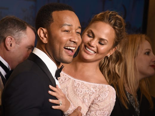 John and Chrissy share a moment at the Golden Globes.
