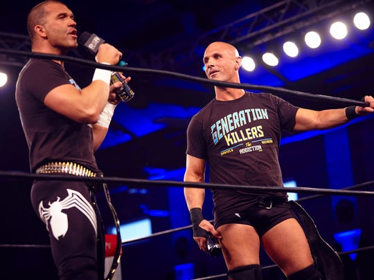 Ring of Honor tag-team champs Frankie Kazarian, left, and Christopher Daniels, cut a promo in the ring.