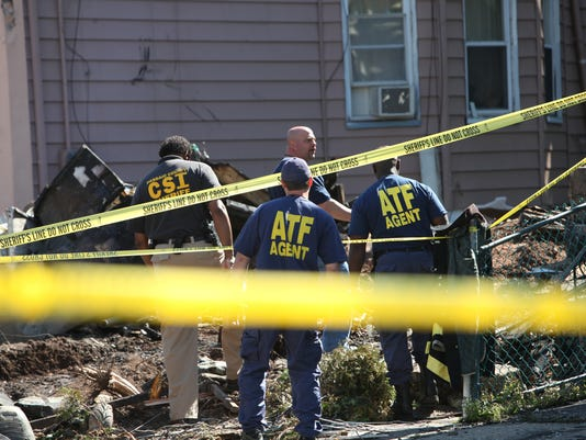 AFTERMATH OF FATAL FIRE: Fire investigators from Paterson, Passaic County and ATF at the scene of a fatal fire where four people died in the early morning hours on Wednesday.