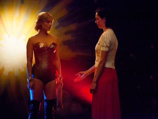 Elizabeth (Rebecca Hall, right) watches as Olive (Bella