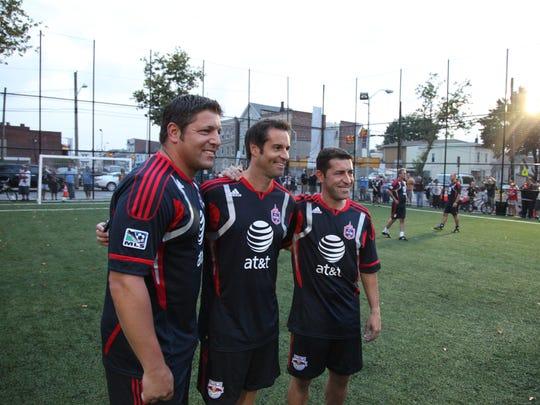 Former U.S. men's soccer team players Tony Meola, left,