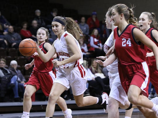 Trinity Law of Brandon Valley dribble the ball during a fastbreak in the middle of several Yankton defenders during Thursday's Throwback Game at the Pentagon.