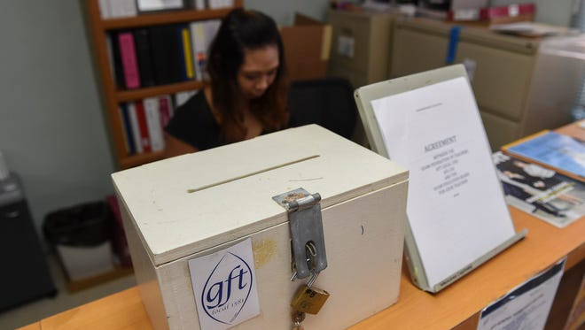 The ballot box and a revised collective bargaining agreement between the Guam Federation of Teachers and the Guam Education Board for Guam Department of Education teachers is displayed at the GFT building in Mangilao on Sept. 15, 2017.