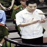 Vietnamese human rights lawyer Nguyen Van Dai testifies in 2007 in Hanoi, Vietnam.