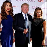 Miss USA and Miss Universe pageant winners pose with Donald Trump in Baton Rouge in 2014.