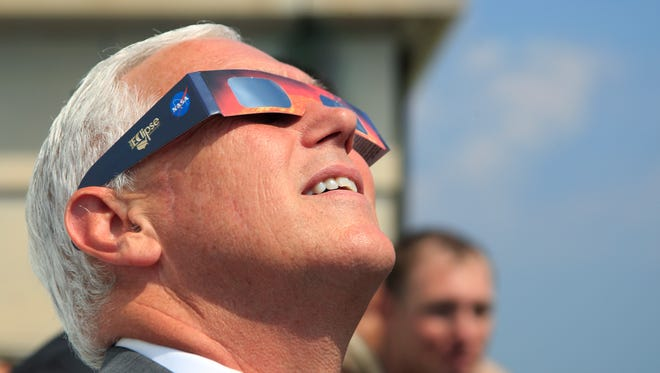 Vice President Mike Pence, watches the solar eclipse, Monday, Aug. 21, 2017, at the U.S. Naval Observatory in Washington.
