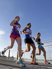 Runners cross the Fox Cities Trestle Trail bridge during