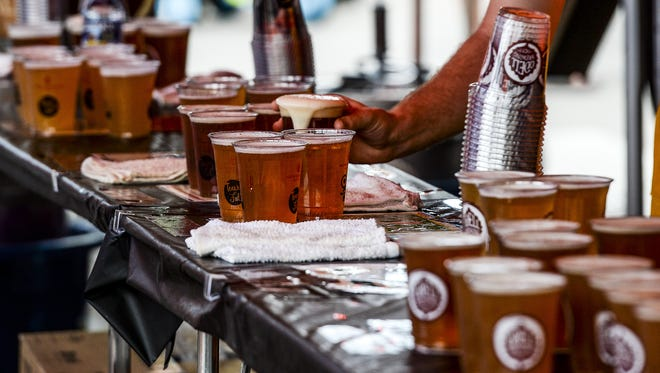 Odell serves up beer during a summer festival.