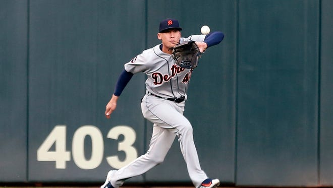 Tigers center fielder JaCoby Jones eyes the ball hit by Minnesota Twins' Brian Dozier in the first inning.