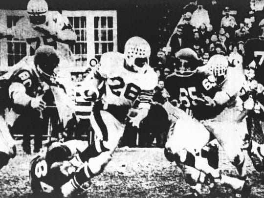 Toms River back Dave Bloom  breaks through Long Branch tacklers in the Indians 41-7 victory in Long Branch in 1968.