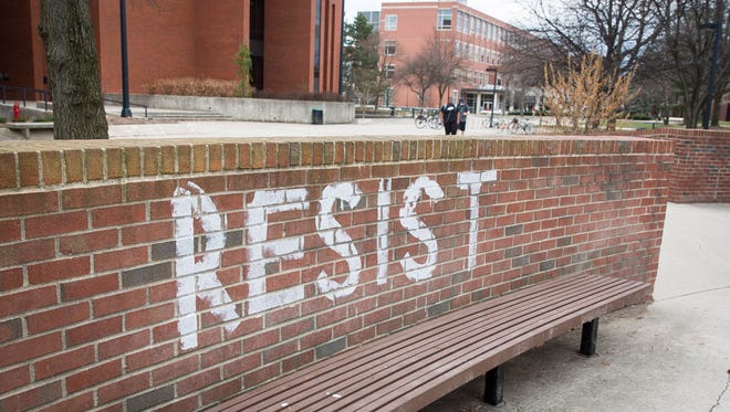 "Graffiti with the word ""resist"" was painted on a brick wall along the University Green on Ball State University's campus Thursday night. Four locations on campus were tagged with the word following a protest over an immigration bill aimed at state universities. The University Police Department is investigating the incident."