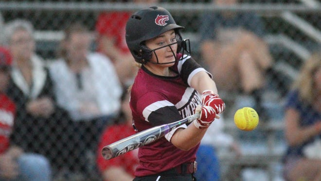 Chiles' Sierra Jevyak drives a ball as part of her 7-RBI night against Leon.