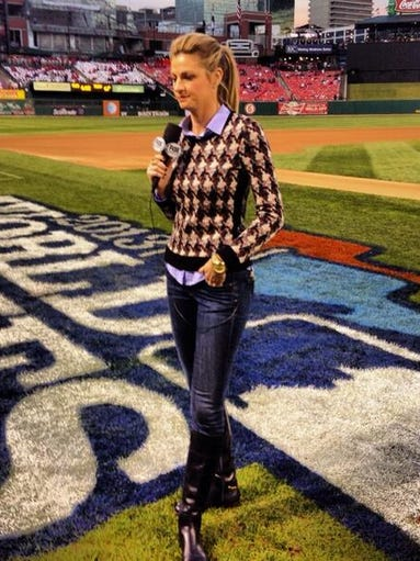 "Fox Sports broadcaster Erin Andrews' ""office"" is a field, so she always has to be camera-ready — but cute and casual — when she goes to work. Here she is before the start of Game 5 of the 2013 World Series at Busch Stadium in St. Louison Oct. 28 in one of her favorite looks, which she describes as ""very preppy ... very Kate Middleton."" USA TODAY's Ann Oldenburg gets some specific fall fashion football tips from the pro for fans."