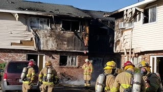 A three-alarm fire that caused two injuries Tuesday at a Gardnerville apartment building is under investigation.