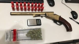 Pictured is the marijuana and short-barreled shotgun seized from five juveniles in Morganfield.