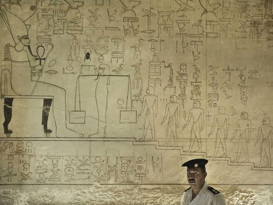 A policeman stands guard at the Horemheb tomb in the Valley of the Kings in Luxor, Egypt.