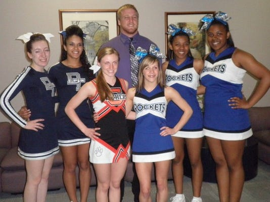 This picture was taken on April 10 at a Big 33 press conference. Shown are cheerleaders Amanda Arnold and DeAja Stepp of Dallastown; Katelyn Zambito of Central York and Tori Allison, Briana Cropper and Bianca Cropper of Spring Grove (lone YAIAA selection Brody Kern is in the middle.)