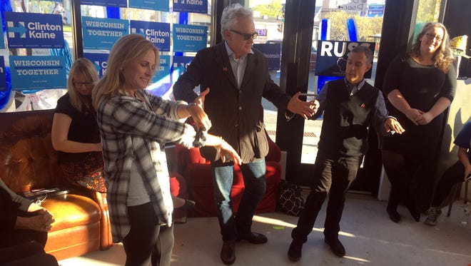 """Actors and """"The West Wing"""" co-stars Marlee Matlin (left) and Bradley Whitford (center) speak to volunteers Saturday at a Democratic campaign office on Milwaukee's north side."""