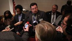 Ferguson mayor Mayor James Knowles III, center, talks