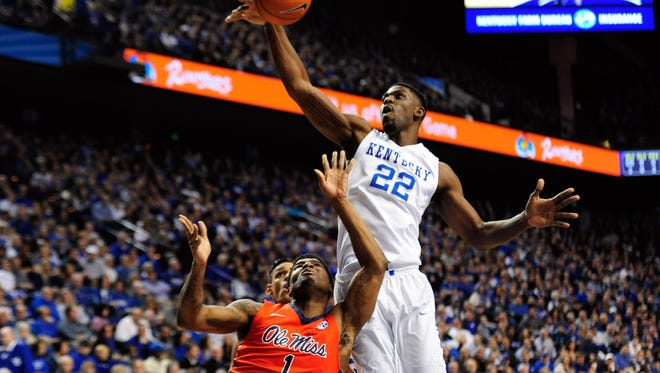 Kentucky Wildcats forward Alex Poythress (22) blocks a shot by Mississippi Rebels guard Martavious Newby (1) during the first half at Rupp Arena.