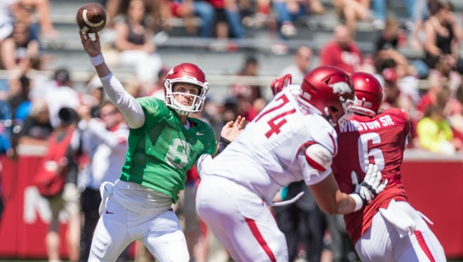 In this file photo, Colton Jackson protects Austin Allen during an Arkansas Spring football game on Saturday. Jackson has been sidelined for the start of the season due to back surgery.