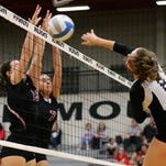 Plymouth's Daniella Barile and Lydia Bell rise for a double block against Churchill's Rayna Yetts.