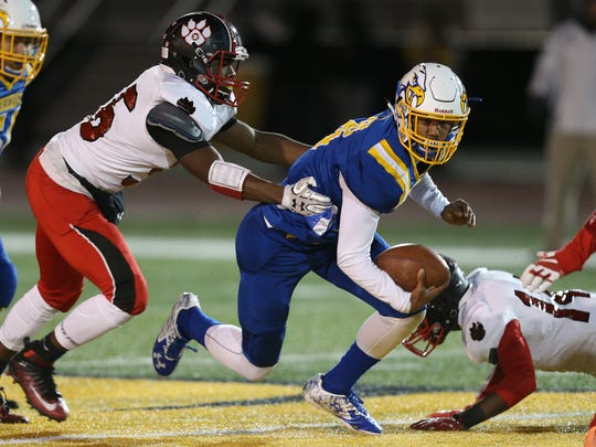 Irondequoit's Freddy June Jr. is tackled from behind against Wilson.