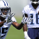 Titans wide receiver Justin Hunter (15) pulls in a pass during drills at St. Thomas Sports Park Tuesday June 16, 2015, in Nashville.