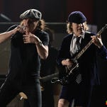 Guitarist Angus Young of AC/DC performs onstage during the Grammy Awards in February.