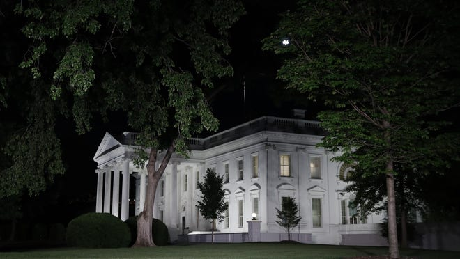 The White House is seen in Washington, Tuesday night, May 9, 2017. President Donald Trump abruptly fired FBI Director Comey on May 9, 2017, ousting the nation's top law enforcement official in the midst of an investigation into whether Trump's campaign had ties to Russia's election meddling. (AP Photo/Carolyn Kaster)