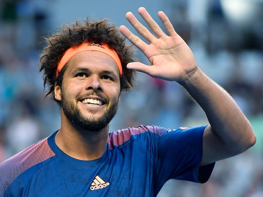 France's Jo-Wilfried Tsonga waves after defeating Britain's Daniel Evans during their fourth round match at the Australian Open tennis championships in Melbourne, Australia, Sunday, Jan. 22, 2017. (AP Photo/Andy Brownbill)