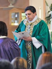 Rev. Ignacio Villafan is accused of felony grand theft stemming from an investigation of suspected money mismanagement at St. Rita's Catholic Church in Tulare.