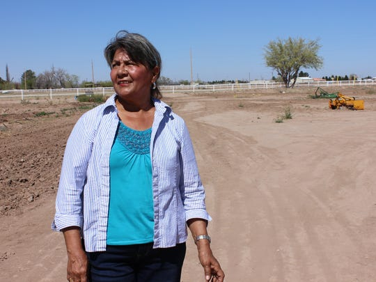 America Terrazas, a resident of Vado-Del Cerro and a community leader with La Cosecha, a program offered by La Semilla Food Center, looks out at the fields of the La Semilla Community Farm in Anthony, N.M., on Saturday, March 18, 2017.