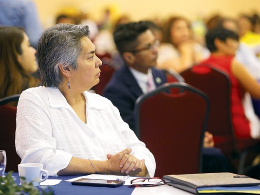 MARK LAMBIE—EL PASO TIMES Atendees at the Paso del Norte Health Foundation Behavioral Health Consortium listen to keynote speaker Linda Rosenberg, president and CEO of the National Council for Behavioral Health.