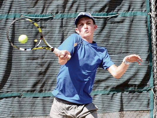 Kevin Wilson — Clovis News-Journal Greg Albright of Carlsbad returns a shot against Kousei Richeson in their No. 2 singles competition Tuesday afternoon at Clovis Community College.