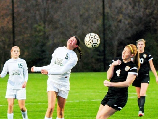 Mickey Heinbaugh of James Buchanan (5) heads the ball away from Lancaster Mennonite's Isabella Clair (4) during a District 3 Class AA girls soccer play-in game Saturday night. It took penalty kicks for the Blazers to pull out a 2-1 victory.