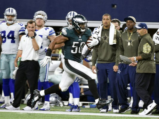 Philadelphia Eagles linebacker Jordan Hicks (58) runs back an interception for a touchdown in the second half on Sunday vs. the Dallas Cowboys in Arlington, Texas. Hicks was placed on season-ending injured reserve after he tore his left pectoral tendon late in the fourth quarter.