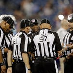 Officials confer in the second half of a preseason game between the Titans and Vikings on Sept. 3 in Nashville, Tenn.