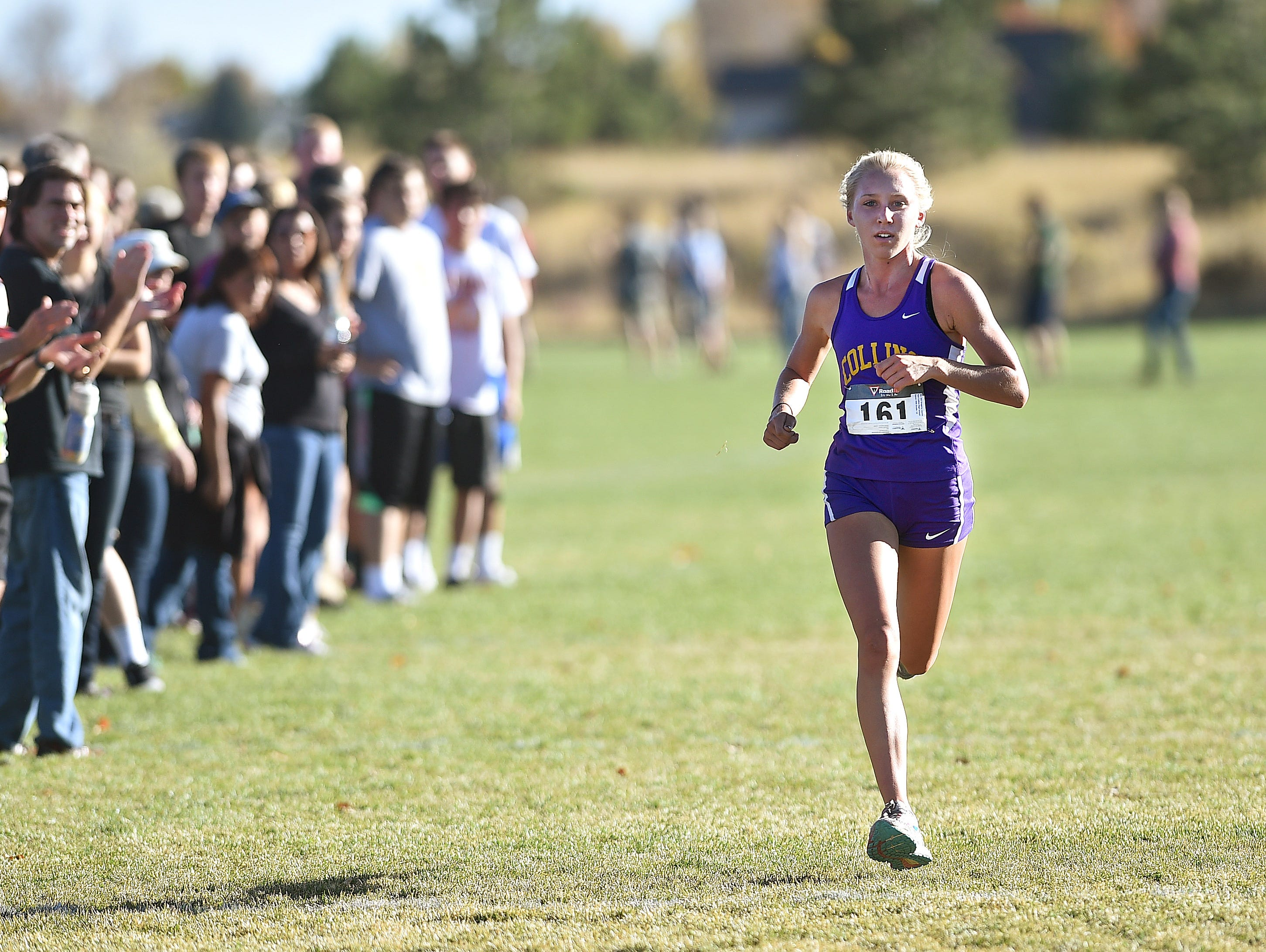 Fort Collins High School's Lauren Gregory approaches the finish line in the regional cross country meet at Spring Canyon Park on Friday, October 21, 2016.