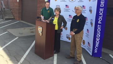 David Seeley, left, and Richard Tantalo join Rep. Louise Slaughter at a news conference Saturday, April 30, 2016, which was National Drug Take Back Day.