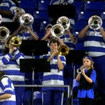 Middle Tennessee pep band adopts autistic child as one of its own