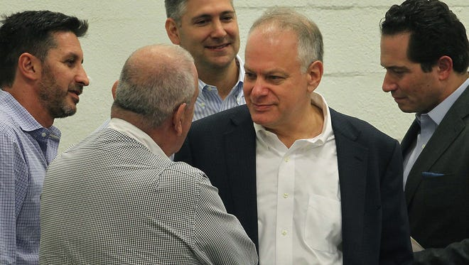 In this Dec. 20, 2016 photo, Stephen Bittel, center, chats with voters as members of the Miami-Dade Democratic Party Executive Committee meet in Wynwood, Fla., to elect a new state committeeman. Florida Democratic Party Chairman Bittel has been accused of sexually inappropriate comments and behavior toward a number of women and has resigned.