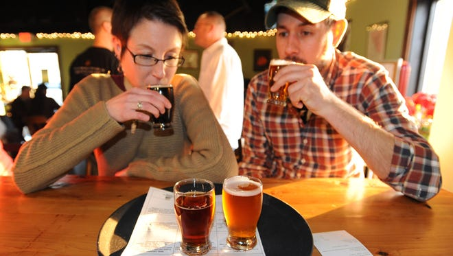 Sara Connolly and Adam Brown, both of Cherry Hill, N.J., sample beer at the Mispillion River Brewing tasting room in Milford. The brewery is the sponsor of the town's new Brewgrass Festival.