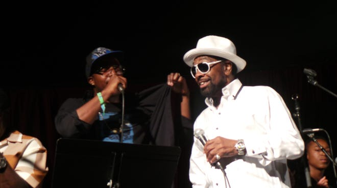 Rapper Al Kapone, left, and R&B great William Bell perform Bell's 1968 hit 'I Forgot to Be Your Lover' at the Bonnaroo Music and Arts Festival in Manchester, Tenn., on June 12, 2014.