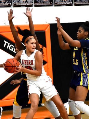 Loveland's Jillian Hayes (10) controls a defensive rebound for the Lady Tigers.