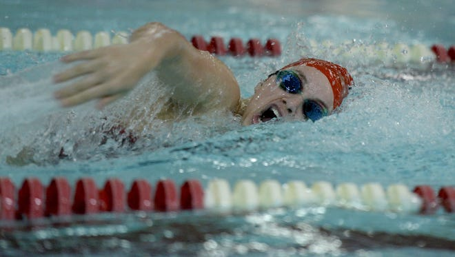 Richmond's Lexi McPherson swims the 200 yard medley relay against Muncie Central during a dual swimming and diving meet Tuesday, Dec. 15, 2015 at Tiano Pool.
