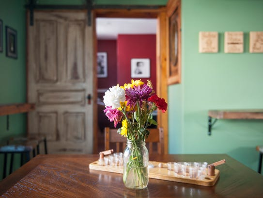 Flowers grace a table on the second floor of Keen in Philadelphia.