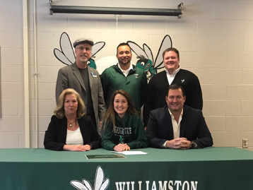 Madison Clem, center, signed her National Letter of Intent to play soccer at Michigan State next season. The senior is the third sister in her family to be a Big Ten goalkeeper.